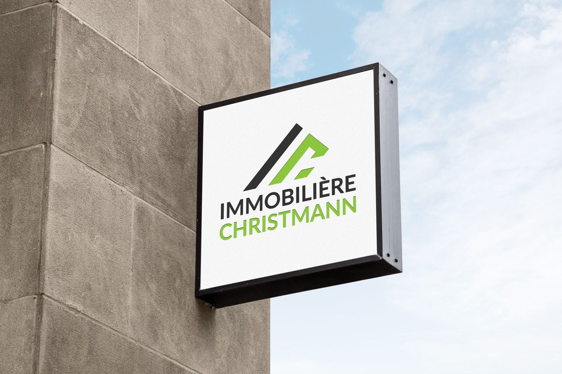 "Shop sign of the real estate and housesitting agency ""Immobilière Christmann""."
