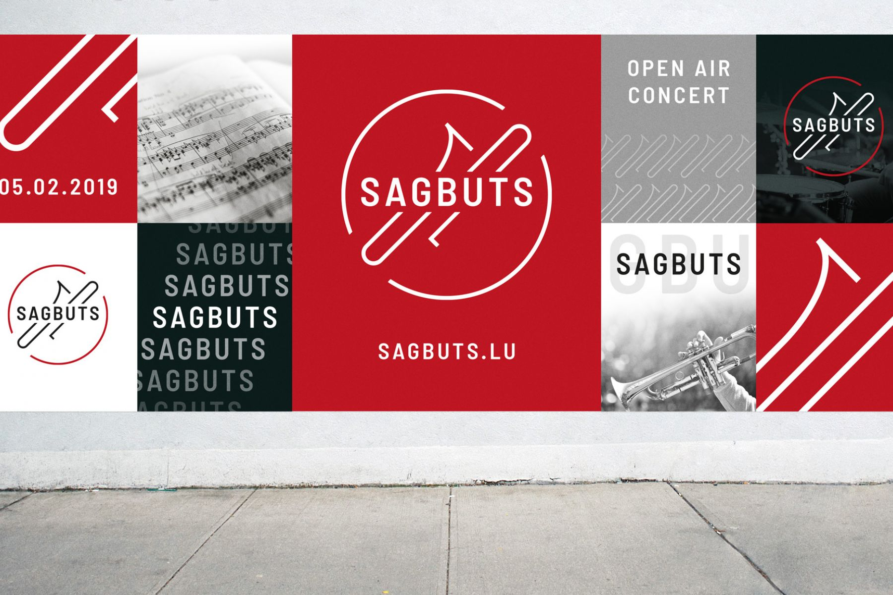 A wall with a lot of posters showing the Sagbuts logo in different ways.